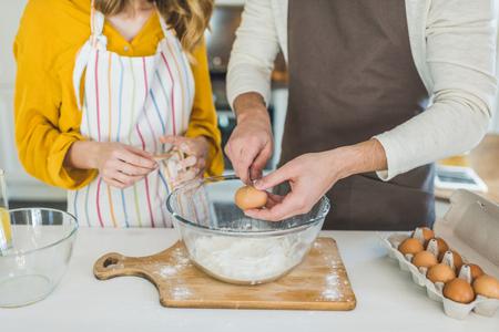 couple making dough Stock Photo