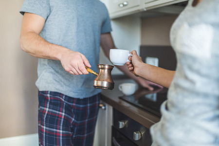 couple preparing coffee