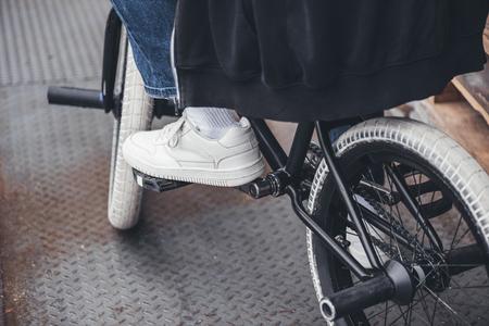 close-up partial view of young man riding bmx bicycle