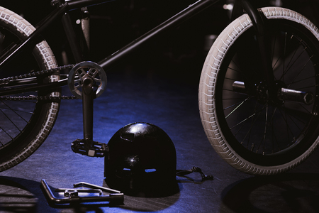 close-up view of bmx bicycle, tools and helmet in studio