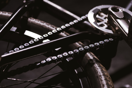close-up view of bmx bicycle chain and wheel