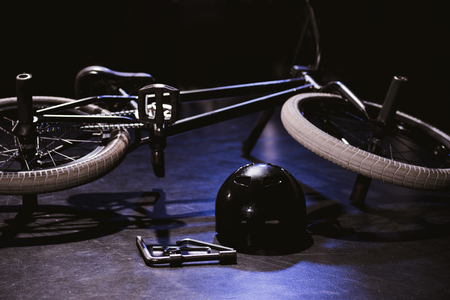 bmx bicycle, tools and helmet in studio