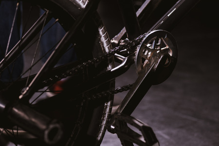 close-up view of bmx bicycle pedal and wheel