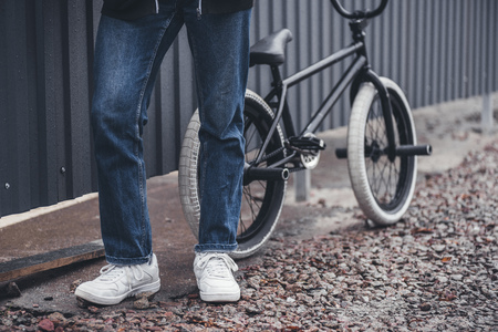 low section of bmx biker standing with bicycle on street   Stock Photo