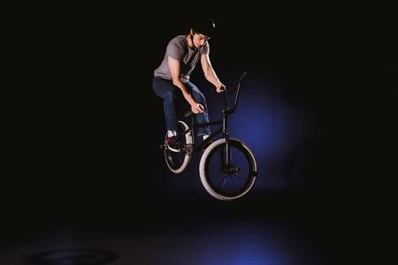 bmx cyclist performing stunt Stock Photo