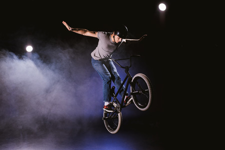 bmx cyclist performing stunt Stock Photo