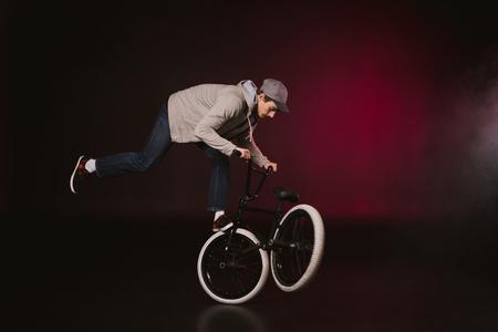 bmx cyclist performing stunt Фото со стока