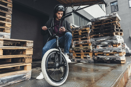 bmx cyclist using smartphone