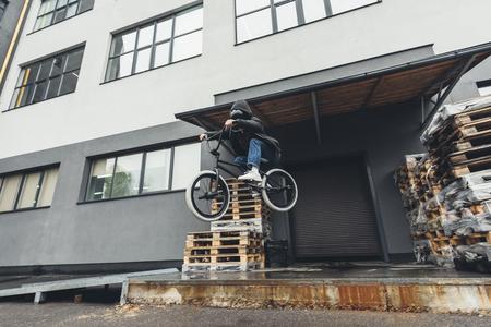 bmx biker jumping on street