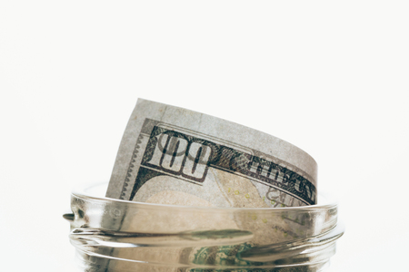 glass jar with dollar banknote isolated on white Stok Fotoğraf