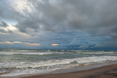 cloudy sky over stormy waving sea at evening Stock Photo