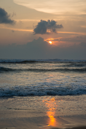 tranquil sunset over wavy sea  Stock Photo