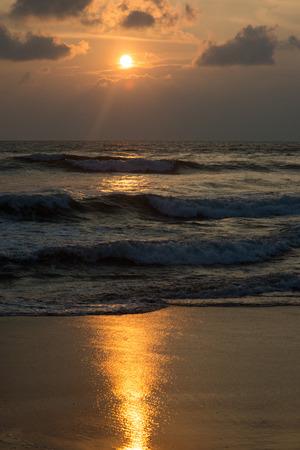 beautiful sunset over wavy sea at sri lanka