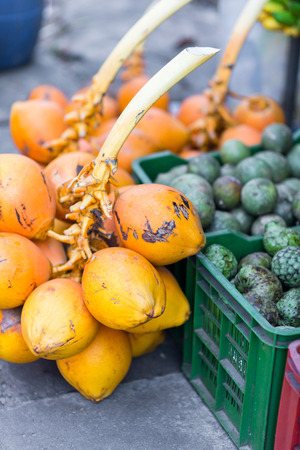fresh tropical fruits selling on market