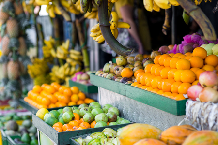 boxes of tropical fruits selling on market Stock Photo