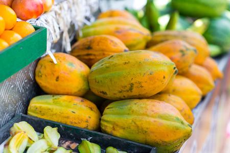 box of fresh papayas selling on market