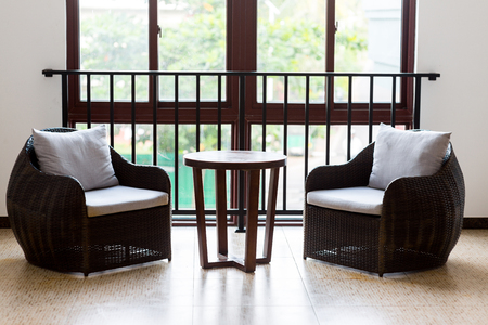 armchairs and coffee table in hotel room