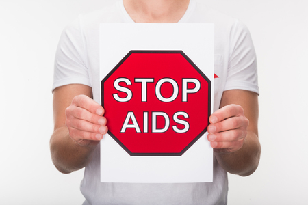 cropped view of man holding stop aids sign, isolated on white Stock Photo