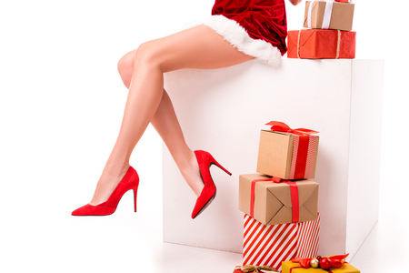 low section of sexy girl in santa costume with presents and gift boxes, isolated on white  Stock Photo