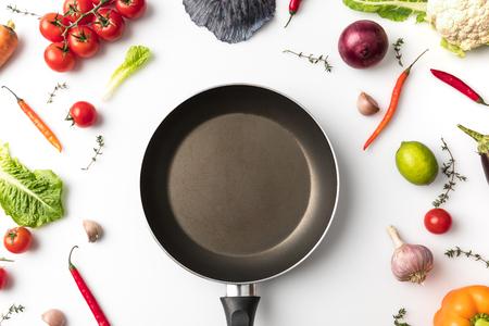 pan among uncooked vegetables Archivio Fotografico