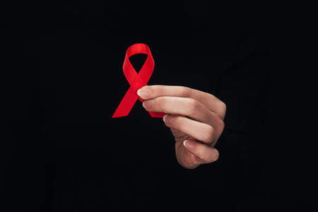 woman with aids ribbon