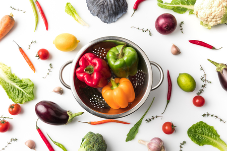 colander with colored bell peppers