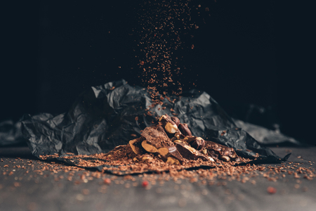Falling pieces of shredded chocolate