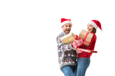 young couple holding christmas gifts stock photo picture and royalty free image image 91617948