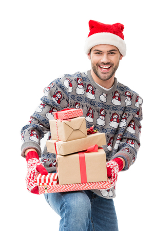 man holding stack of christmas gifts Stock Photo