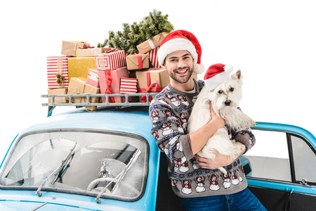 man with dog and christmas gifts on car Stock Photo