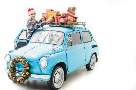 man wiith christmas gifts on car roof