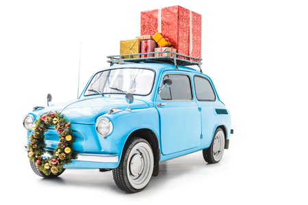 car with christmas wreath and gifts on roof