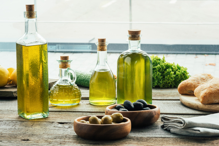 olive oil bottles with vegetables