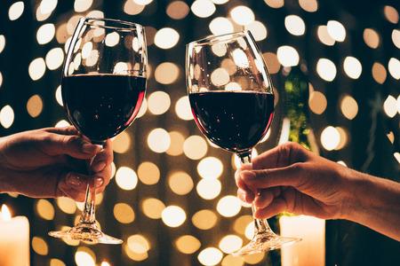 women clinking glasses with wine Stok Fotoğraf
