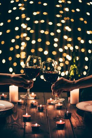 Women clinking glasses at dinner
