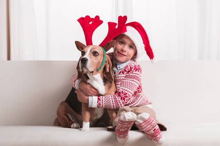 boy and his dog on christmas