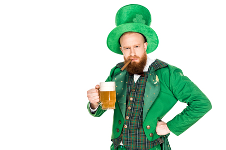 bearded man in green costume holding cigar and glass of beer