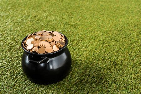 golden coins in pot standing