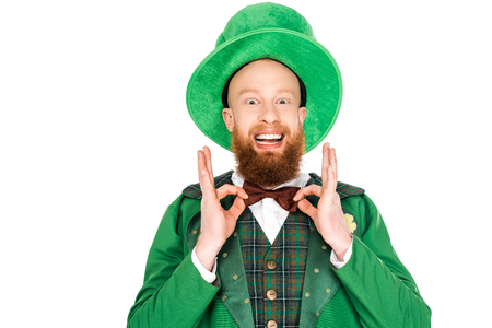 excited man in green leprechaun costume and bow tie Stock Photo