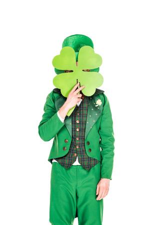 leprechaun in green suit holding clover leaf Stock fotó