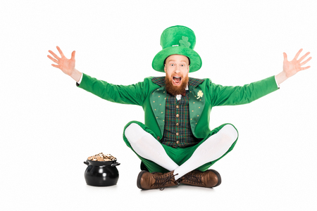 excited leprechaun gesturing and sitting at pot of gold