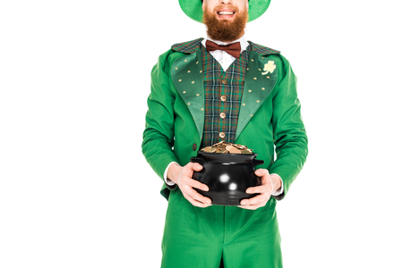 cropped view of leprechaun in green suit holding pot of gold