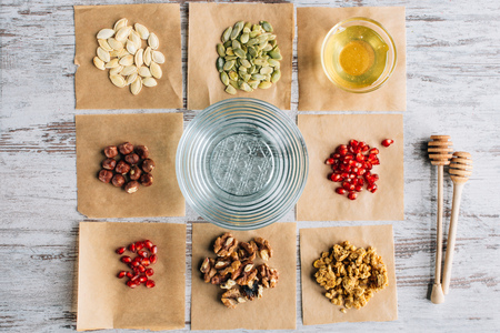 granola ingredients on baking parchment pieces on table Stock Photo