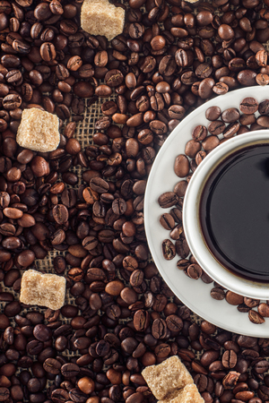 cup of coffee, roasted coffee beans and brown sugar
