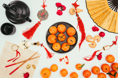 various chinese talimans with tangerines and tea isolated on white, Chinese New Year concept 스톡 콘텐츠