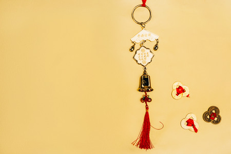 traditional chinese talisman with coins on yellow, Chinese New Year concept