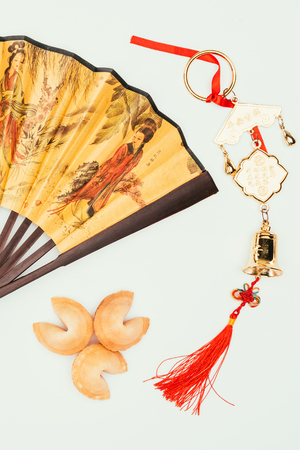 traditional chinese handheld fan with talisman and fortune cookies isolated on white, Chinese New Year concept Stock Photo