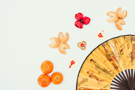 top view of chinese new year composition with handheld fan Stock Photo
