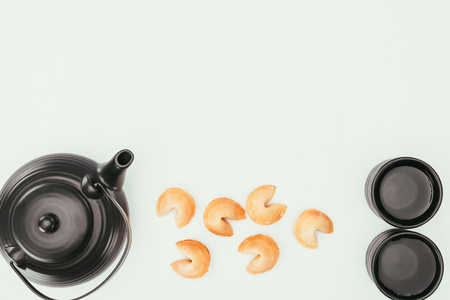 top view of chinese teapot with fortune cookies Stock Photo
