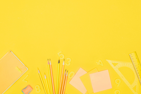 composition of colorful school supplies isolated on yellow background Stok Fotoğraf